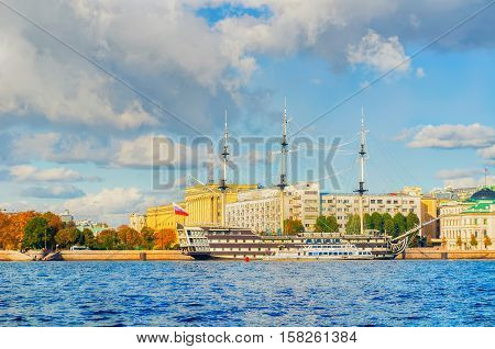 ST PETERSBURG RUSSIA- OCTOBER 3 2016. Petrovsky embankment Neva river and frigate Grace in St Petersburg Russia.Frigate is a historical reconstruction of the three-Decker ships of the XVIII century