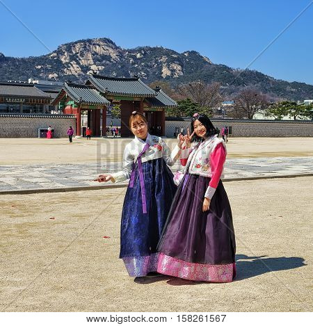 Young Girls In Traditional Costumes At Gyeongbokgung Palace Seoul