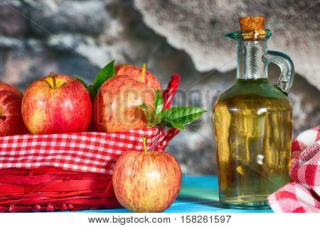 Homemade Vinegar galas apples on a table in a farmhouse