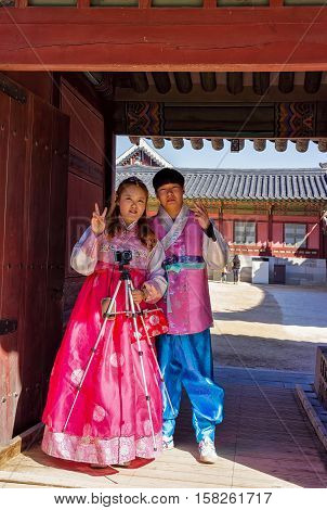 Young People In Traditional Korean Costumes Near Gyeongbokgung Palace Seoul
