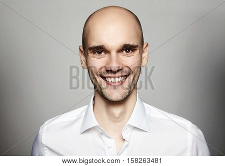 Smiling Man In White Shirt