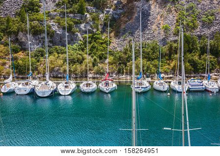 White and graceful sailing yachts in turquoise water of the gulf. Small fjords in Calanque National Park between Marseille and Cassis