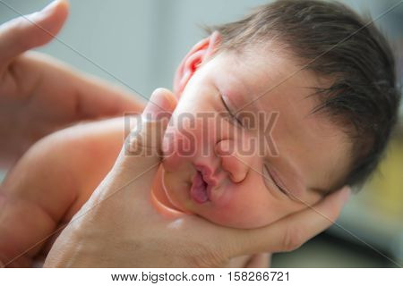 Mother Breastfeeding Her Newborn Baby