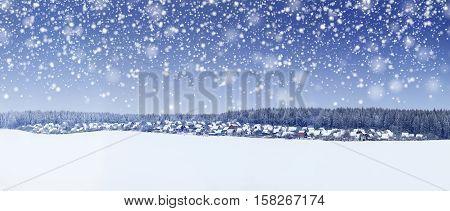 Christmas panorama of snowy morning. xmas winter background. Snowfall in Christmas morning.