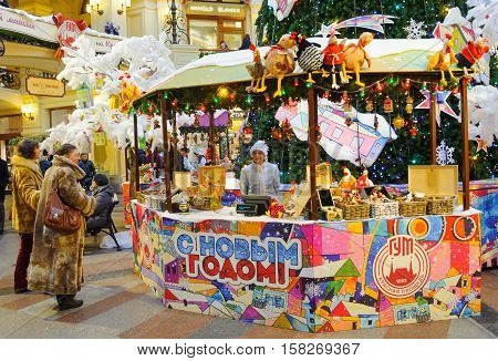 MOSCOW - NOVEMBER 22: People near counter at the New Year Fair in GUM on November 22 2016 in Moscow.