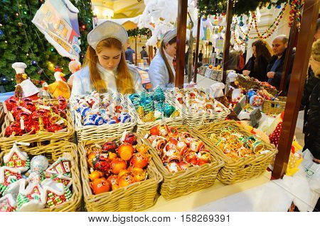 MOSCOW - NOVEMBER 22: Saleswomen and buyers at the New Year Fair in GUM on November 22 2016 in Moscow.