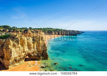 a view of beautiful sandy beach Dona Ana in Lagos Algarve region Portugal