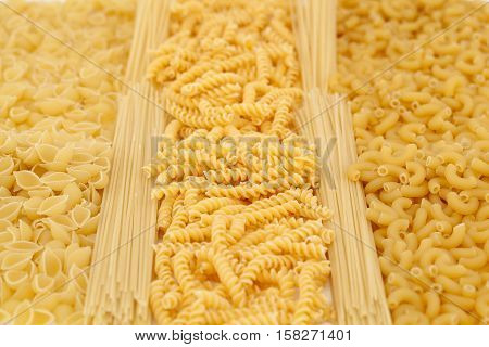 different types of raw pasta as background