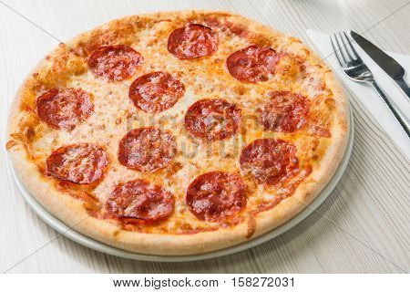 Salami pizza on the table in restaurant