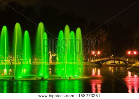 Fountain With Green Backlight In Park