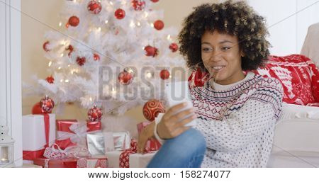Pretty young woman video chatting on her smartphone