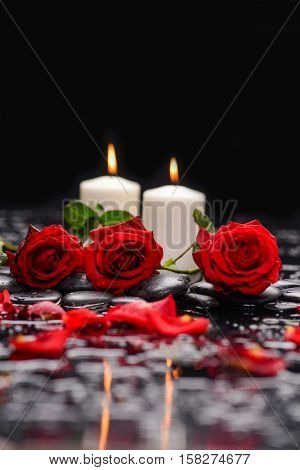 Still life with red rose with two candle and therapy stones