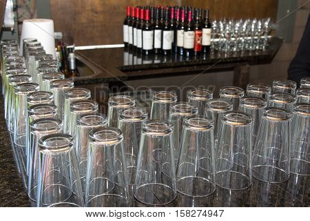 rows of glasses lined up on the bar