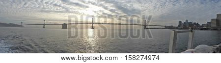 The Oakland Bay Bridge in the Bay of San Franciscoin the early morning