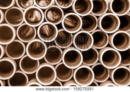 Stack of pipes waiting on a construction site