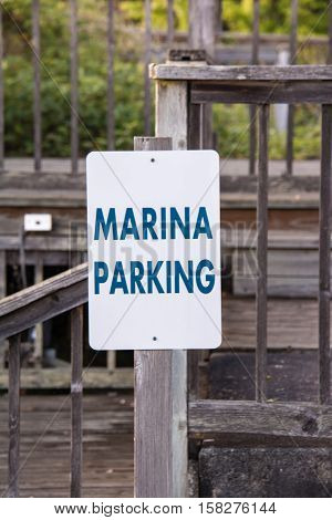 A marina parking sign mounted on a post