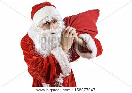 Jolly Santa Claus in a red suit with a New Year's bag with gifts on a white fone.Isolated