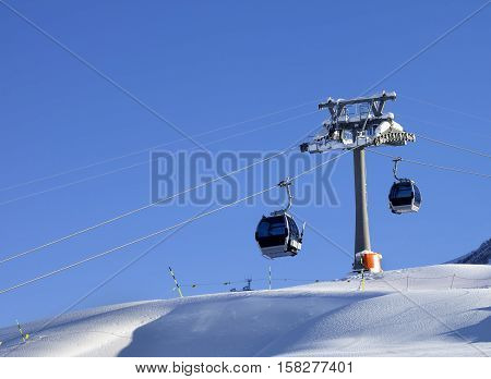 Gondola Lift And Off-piste Slope With New-fallen Snow On Ski Resort At Sunny Evening