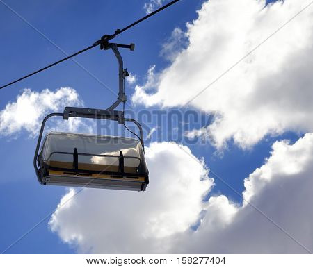 Chair-lift And Sunlight Sky