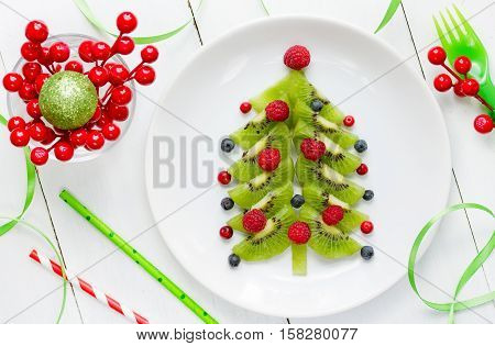 Funny edible Christmas tree Christmas breakfast idea for kids. Beautiful Christmas and New Year food background