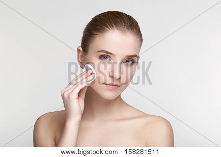 Beauty portrait young woman healthy skin care health white background smile healthcare treatment copy space black mask salve close up Sponge tips cotton pad