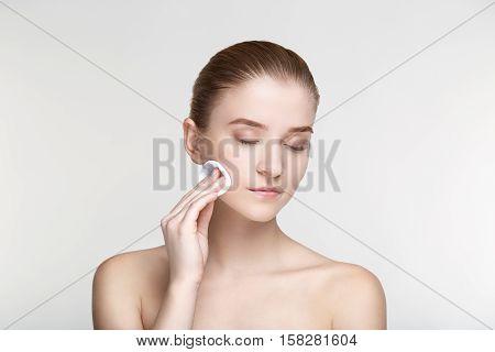 Beauty portrait young woman healthy skin care health white background smile healthcare treatment copy space black mask salve close up Sponge tips cotton pad