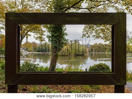 View Through Large Hollow Picture Frame Of Trees And Pond