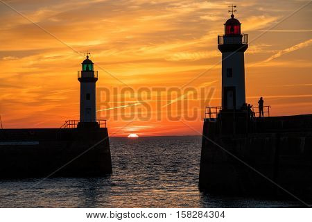 Sunrise and lighthouse in Britain at dawn