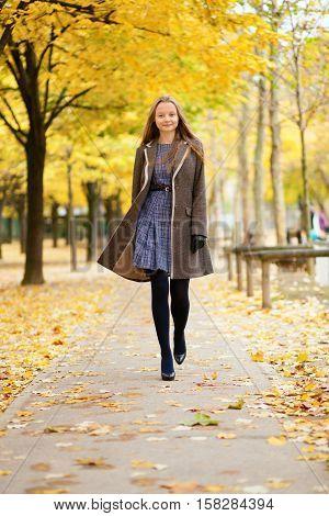 Happy Beautful Girl Walking In Park On A Fall Day