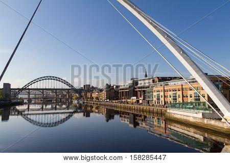 Newcastle Gateshead Quayside with River Tyne Gateshead Millenium Bridge and Tyne Bridge in view