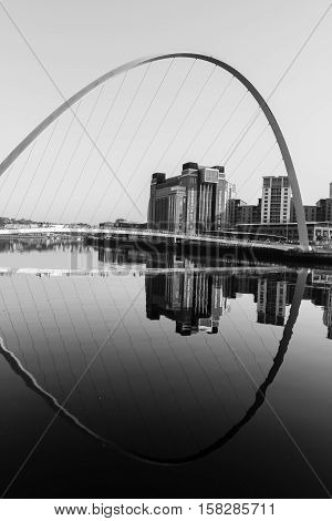 Gateshead Millennium Bridge and Baltic Centre for Contemporary Art with reflections in River Tyne in Black and WHite