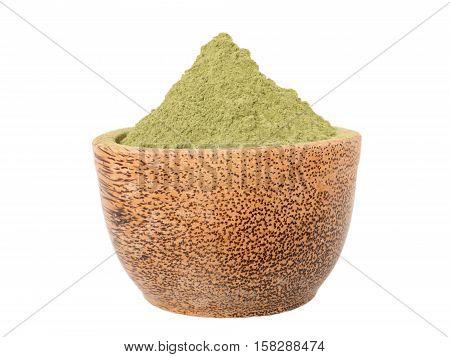 Indigo indigofera tinctoria powder in the coconut bowl isolated on white