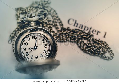 Pocket Watch on the open Book with Blank Space in Vintage Tone