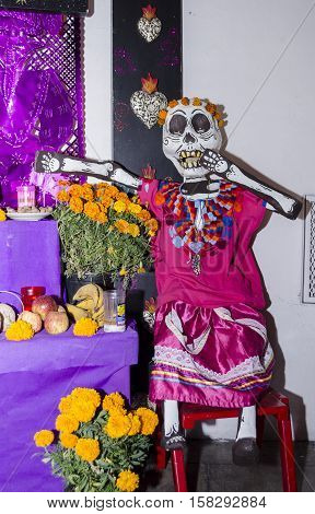 OAXACA, OAXACA, MEXICO - NOVEMBER 1, 2016: Big skull made of paper. Part of a mexican day of the dead offering altar in Oaxaca, Oaxaca, Mexico