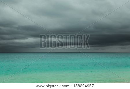 gorgeous amazing mesmerizing background view of stormy weather tropical dramatic sky and tranquil ocean