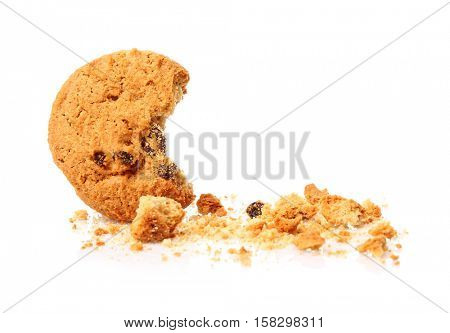 Tasty cookie with chocolate chips and crumbs on white background