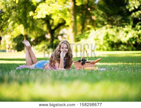 Beautiful Young Girl Having A Picnic In Park