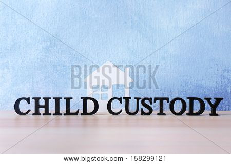 Words CHILD CUSTODY on light background