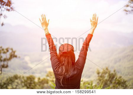 Woman feeling victorious facing on the mountain Thailand