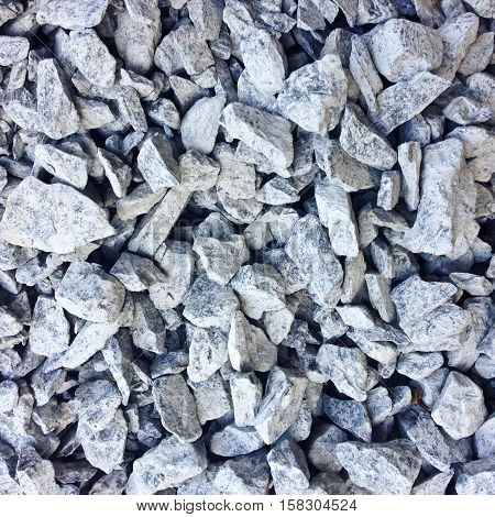 small rock or stone. It's a building materials by mixed with sand and concrete, for texture background.