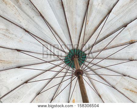 close up old white umbrella fabric texture