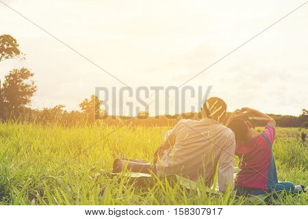 Family with mountain view,Or Father and son are happy with travel and picnic with mountain and sunshine view.