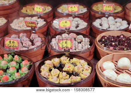 Chinese Food steamed dimsum in bamboo containers traditional cuisine