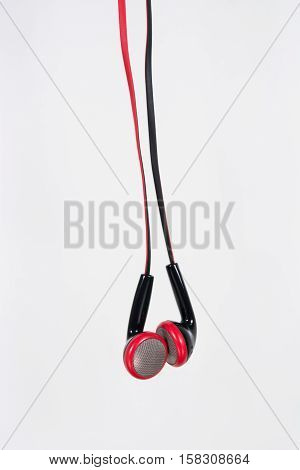 ear buds or earphones vertical on white background
