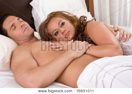 Young sexy naked heterosexual couple love in bed poster