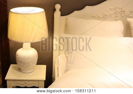 Bed with  pillow in the interior with lamps