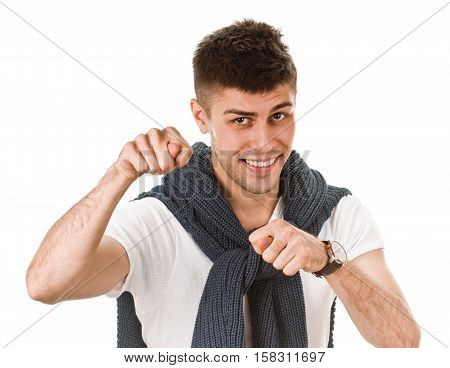 young man shows sign fig on white background