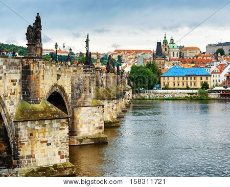PRAGUE, CZECH REPUBLIC - AUGUST 11, 2014: View of the Charles Bridge and the Lesser Town (Little Quarter) in Prague Czech Republic.