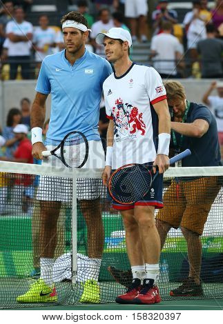 RIO DE JANEIRO, BRAZIL - AUGUST 14, 2016: Juan Martin Del Porto of Argentina (L) and  Andy Murray of Great Britain before men's singles final of the Rio 2016 Olympic Games at the Olympic Tennis Centre