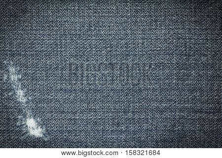 Denim jeans texture or denim jeans background with old torn. Old grunge vintage denim jeans. Stitched texture denim jeans background of jeans fashion design.